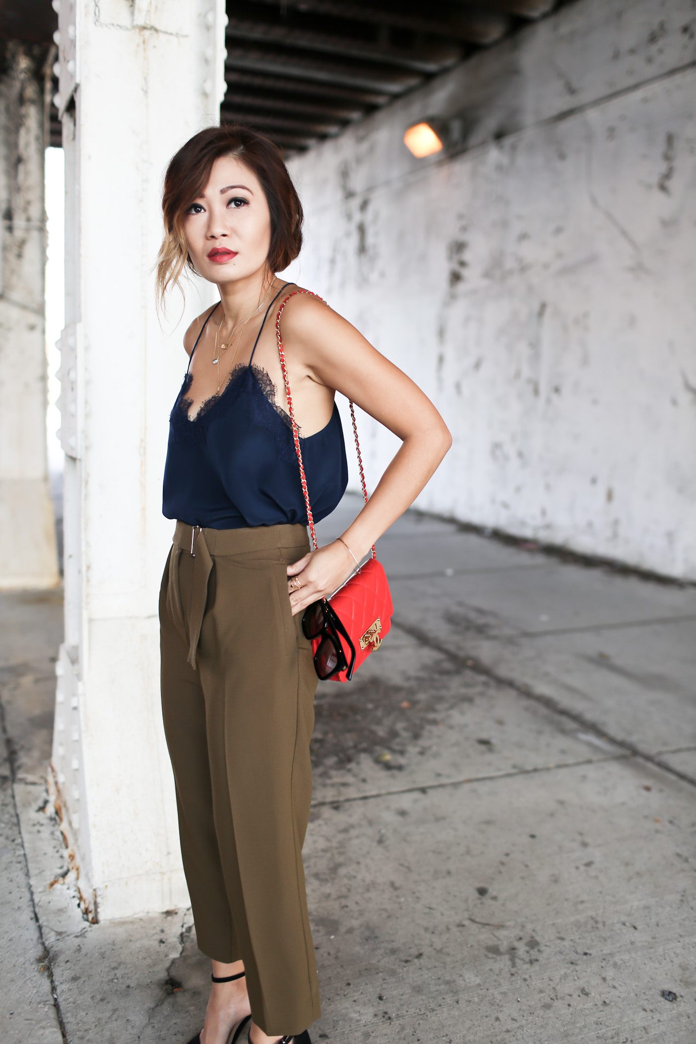 tucked lace cami with tapered trousers
