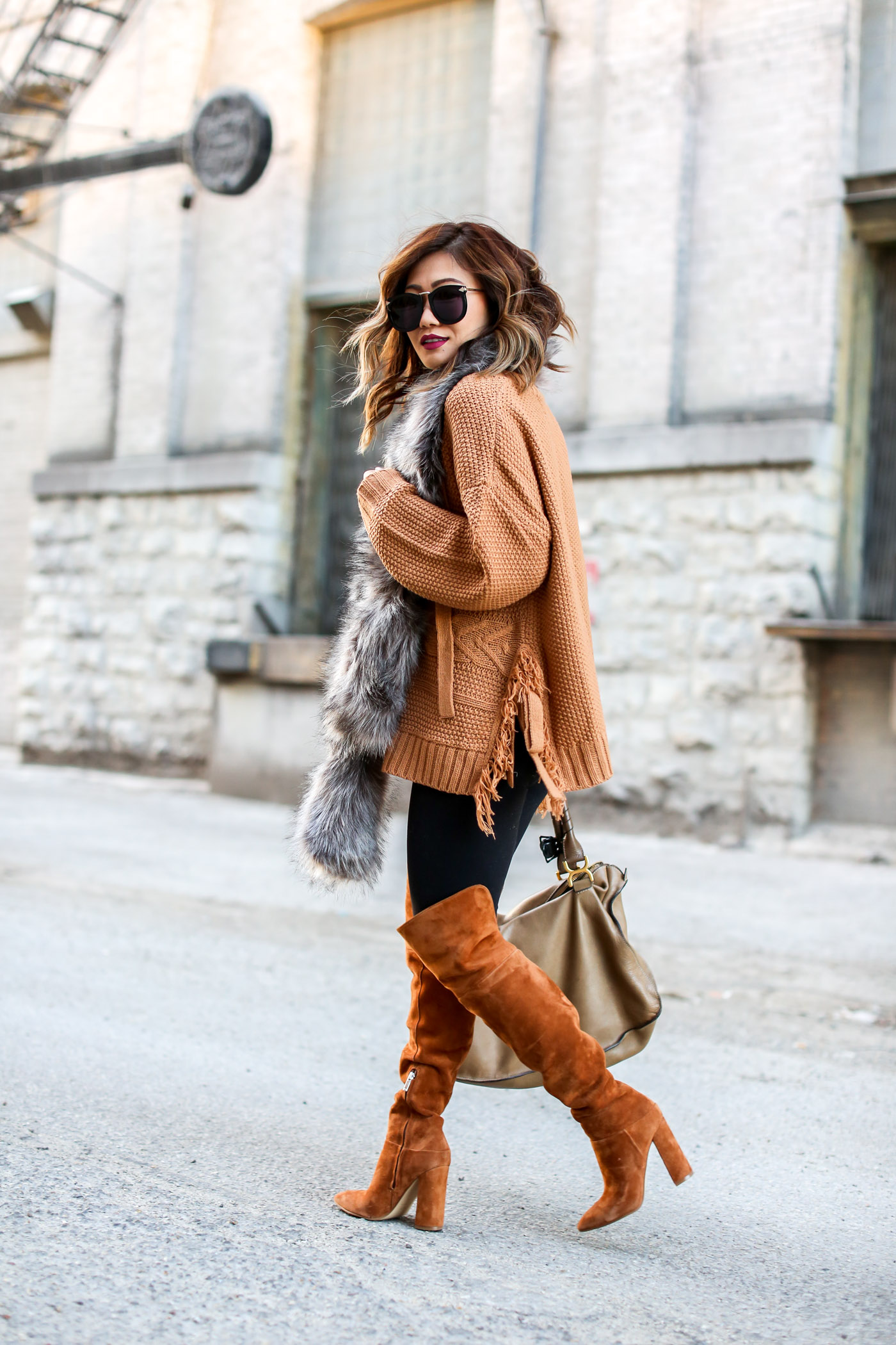 asos camel lace up sweater and faux fur shawl with over the knee marc fisher boots
