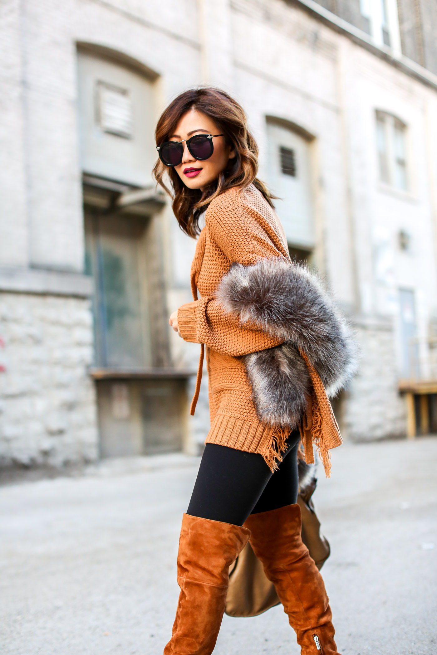 asos camel lace up sweater and faux fur shawl with over the knee marc fisher boots and faux fur stole