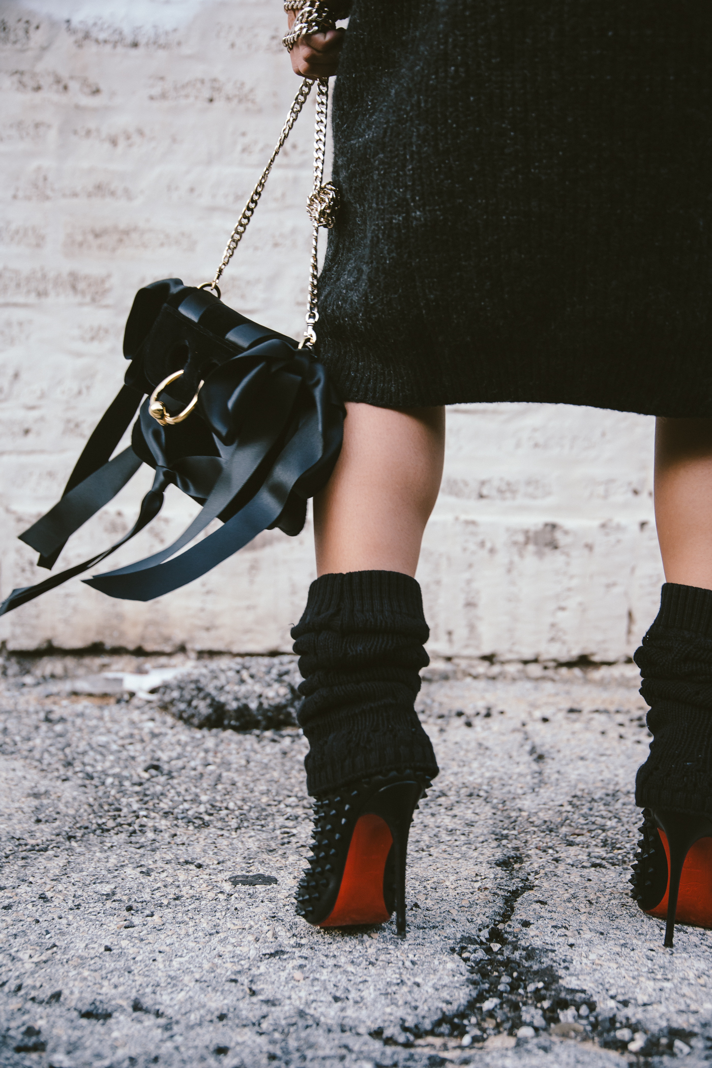 oversized sweater dress with christian louboutin ankle boots and leg warmers newsboy cap and jw anderson bow pierce bag